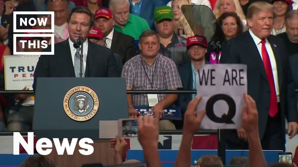 QAnon Internet Conspiracy Group Surfaces at Trump Rally in Florida | NowThis